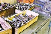 picture of workbench  - boxes with old bolts on workbench in turnery room - JPG