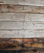 old de-nailed pine wood pallet boards placed side by side for a wooden abstract background or wallpaper. wood is used around the world for many things and is made from trees which grow in the forest