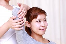 picture of chiropractic  - woman getting a chiropractic in the chiropractic office - JPG