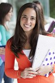 image of teenagers  - Group of smiling teenagers with folders and school bags - JPG