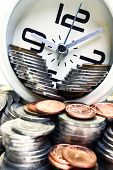 stock photo of money prize  - A clock on a pile of coins representing time is money - JPG