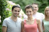 image of heterosexual couple  - Portrait of a happy young heterosexual couple looking at camera - JPG