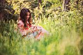 foto of doll  - child girl dressed as fairytale princess playing with doll in summer forest - JPG