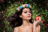 picture of garden eden  - beautiful girl with a wreath on his head with apple - JPG