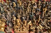 stock photo of hindu  - Collection of Buddhist and Hindu god statuettes and souvenirs - JPG