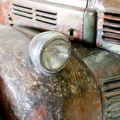 picture of headlight  - Closeup design of rusting car headlight background - JPG