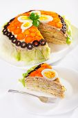 foto of iceberg  - Salty cake made from pancakes tuna fish eggs carrots olives and iceberg salad - JPG