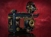 image of steampunk  - Camera steampunk on a red background - JPG