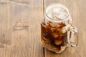 stock photo of frappe  - Iced coffee with milk in vintage jar - JPG
