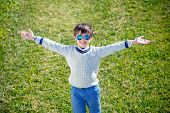 image of rapture  - Cheerful little boy having relax outdoors during his summer vacation - JPG