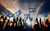 stock photo of israel people  - Silhouettes of People Holding Flag of Israel - JPG