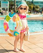 stock photo of swimming  - little cute girl near the pool with a circle for swimming - JPG