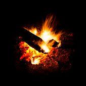 foto of bonfire  - Blaze of catching bonfire on black background - JPG