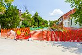 picture of safety barrier  - Construction site is protected by several traffic signs and orange fence for safety - JPG