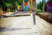 foto of hydraulics  - Excavator has attached hydraulic plug - JPG
