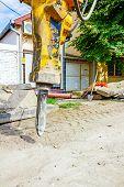 stock photo of hydraulics  - Excavator has attached hydraulic plug - JPG