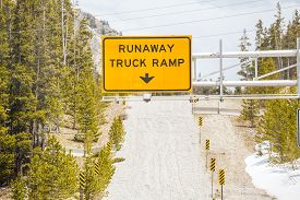 picture of runaway  - Runaway Truck Ramp and Road Sign . ** Note: Shallow depth of field - JPG