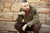 Bearded man smoking weed outdoors poster