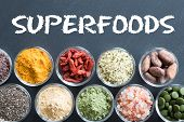 Selection Of Superfoods On A Black Background poster