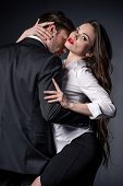 Young Passionate Couple In Love Hugging In Erotic Scene poster