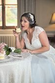Cheeky Bride Is About To Take A Bit Out Of A Cup Cake poster