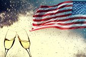 Celebrating Independence Day. United States of America USA flag with fireworks and champagne backgro poster