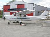 Small Airplane Near Hangar