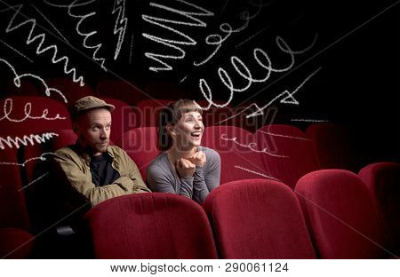 Young cute couple sitting in