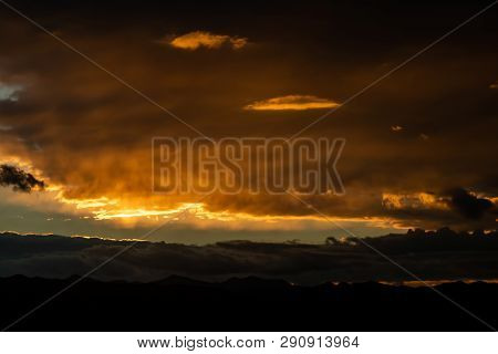 Sunset Over Mountains With Many
