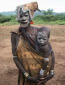 A tribal woman from Ethiopia, while wearing a clay lip insert as traditional decoration