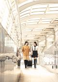 Young Woman With Travel Bag Walking At The Airport For Traveler Tourism. poster