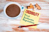 Credibility Concept. Text On A Napkin With A Cup Of Coffee poster