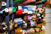 Colorful Embroidery Thread Spool Using In Garment Industry, Row Of Multicolored Yarn Rolls, Sewing M poster