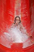Girl riding down a waterslide