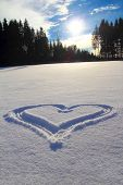 stock photo of bottomless  - Heart In The Snow with sun and blue sky - JPG