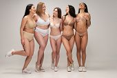 Five Cheerful Multicultural Young Women In Lingerie Hugging While Posing At Camera, Body Positivity  poster
