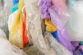 Used Bubble Wraps Of Different Colors At The Recycling Plant. Close-up Of White, Yellow, Purple, Blu poster