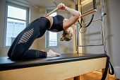Gym Woman Pilates Stretching Sport In Reformer Bed Instructor Girl. Healthy Smiling Woman Wearing Le poster