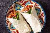 Typical Mexican Burrito Wrap With Beef, Frijoles And Vegetables On Black Background. Top View. poster