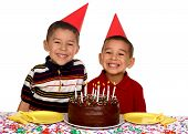 picture of birthday party  - Two young boys ready to eat a birthday cake - JPG