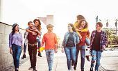 Group Of Happy Friends Having Fun Outdoor - Young People Piggybacking While Laughing And Walking Tog poster