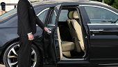 Chauffeur Opening Luxury Car Door For Vips poster