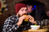 Brutal Hipster Bearded Man Sit At Bar Counter. High Calorie Food. Cheat Meal. Delicious Burger Conce poster