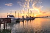 Break Of Dawn Sunrise Over Boats And Sailboats At Factory Bay Marina In Marco Island poster