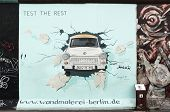 BERLIN - AUGUST 22: Famous painting by Birgit Kinder of the Trabant on Berlin Wall at East Side Gall