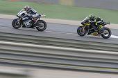 CHESTE - NOVEMBER 11: Katsuyuki Nakasuga first & Cal Crutchlow during MOTOGP Race of the Comunitat Valenciana, on November 11, 2012, in Ricardo Tormo Circuit of Cheste, Valencia, Spain