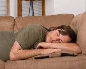 Man fast asleep on the couch