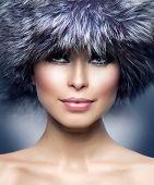 Winter Girl. Fur Fashion. Beautiful Woman in Fur Hat. Winter Woman Portrait