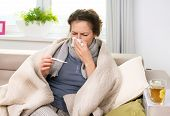 Sick Woman with Thermometer.Flu.Woman Caught Cold. Sneezing into Tissue. Headache.Virus.Flue