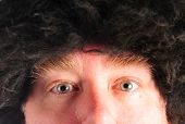 picture of mongol  - Mongol man in a fuzzy hat - JPG